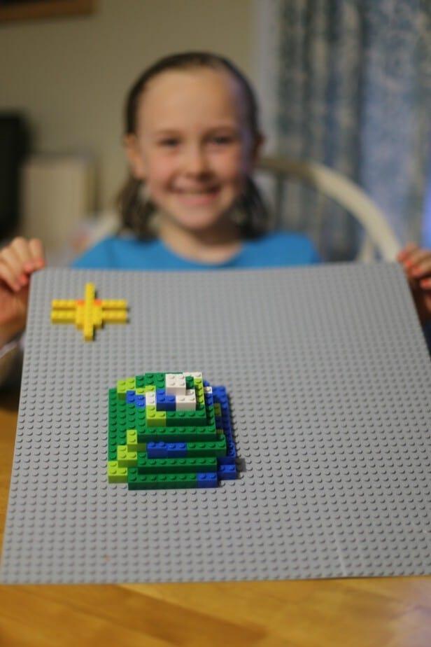 girls-building-legos-earth