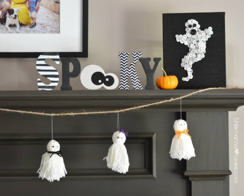 yarn craft ghost garland on black mantel