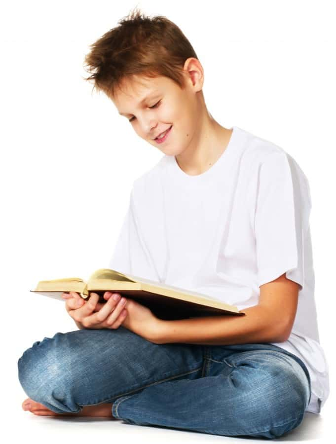 tween boy reading the book
