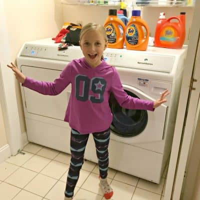 3 reasons to get your kids involved with the laundry 8 year old helps do laundry