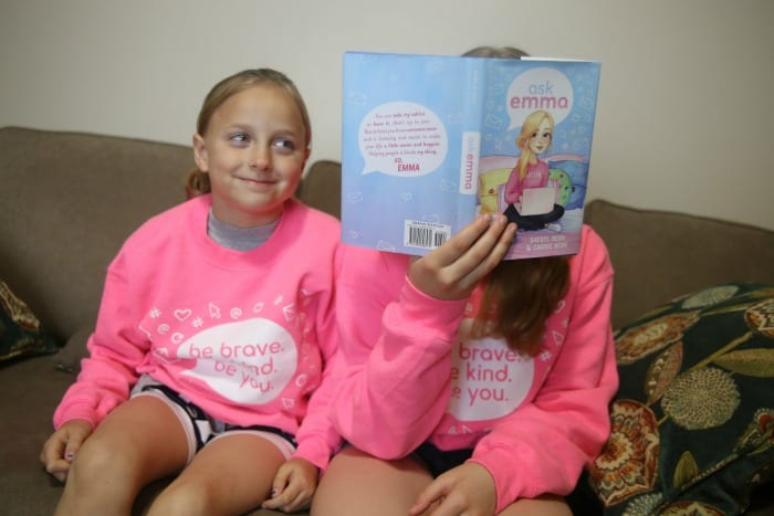 sisters reading ask emma book