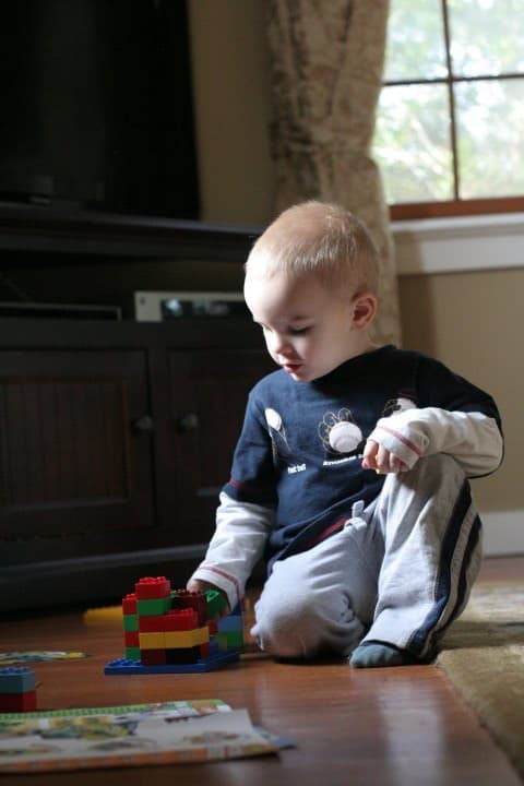 toddler playing lego