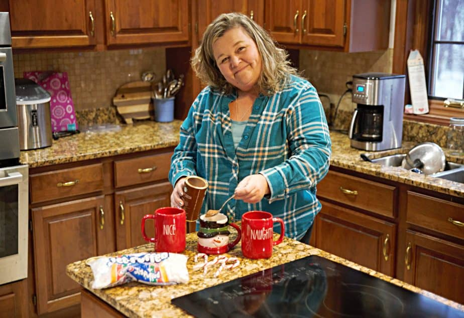 making cooca with rae dunn red holiday mugs