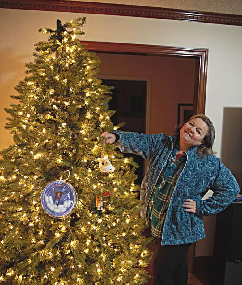putting ornaments on tree (1)