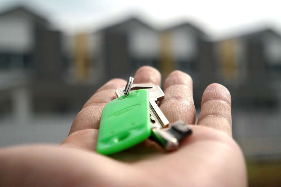 keys on green keyring in outstretched hand
