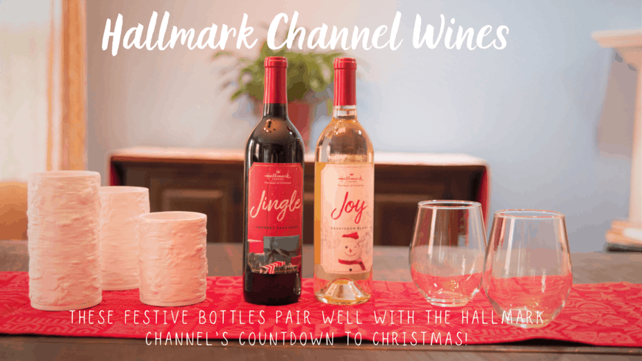 hallmark channel bottles of wine on red table runner with wine glasses and white candle holders