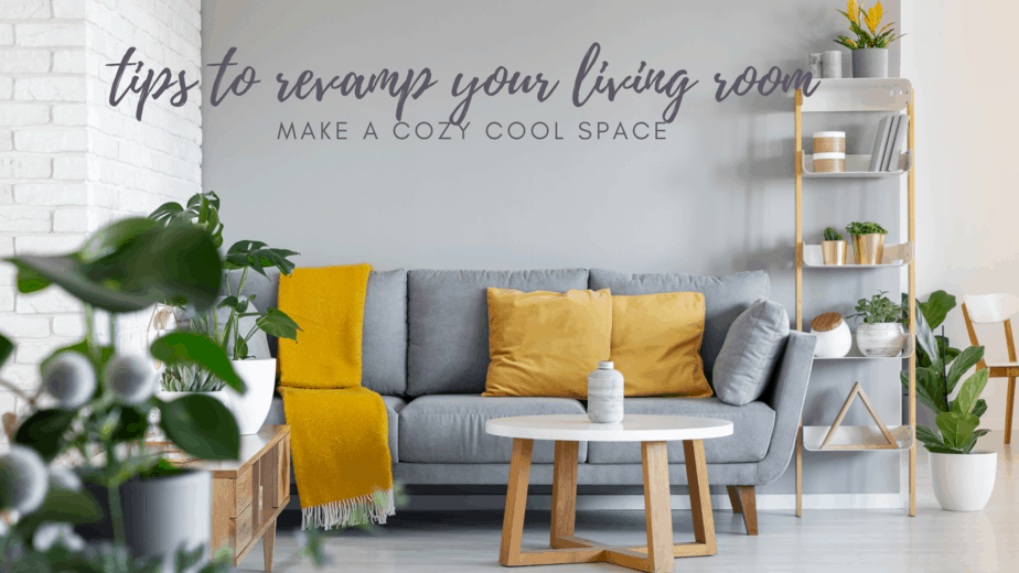 grey couch with mustard cushions in front of grey accent wall