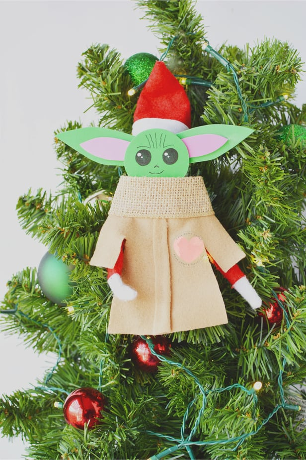 elf on the shelf with baby yoda costume over it