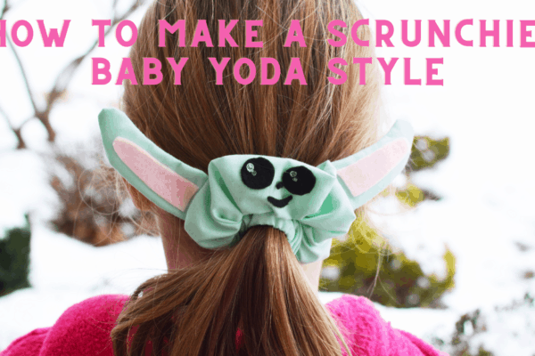 back of girl's head with hair in ponytail wrapped in homemade baby yoda scrunchie