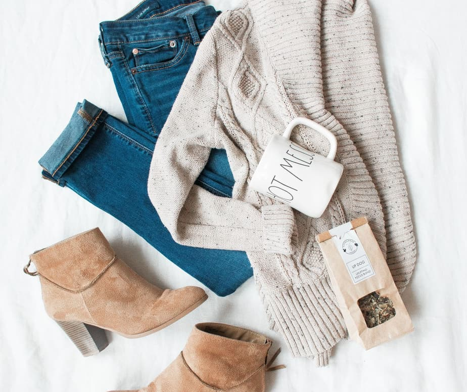overlay of neutral toned outfit with jeans