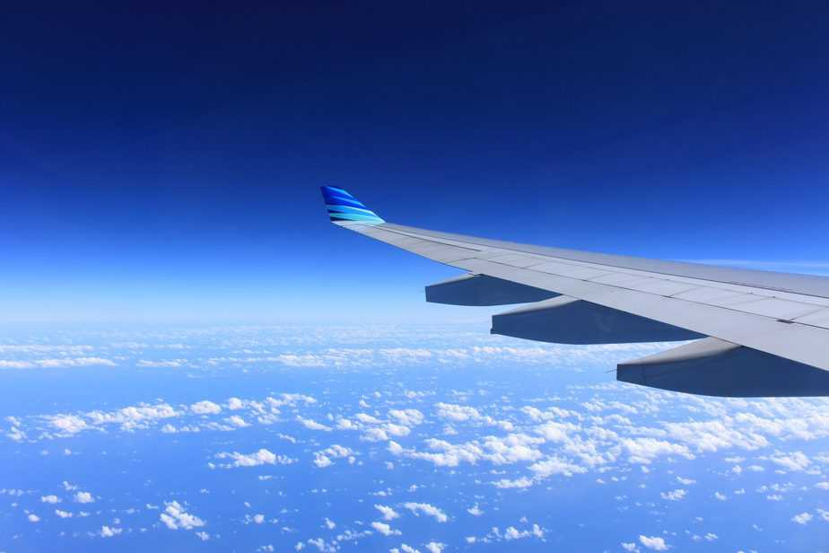 plane wing out of window in flight