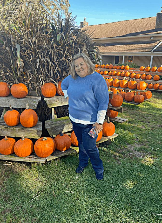 standing in front of display of pumpkins